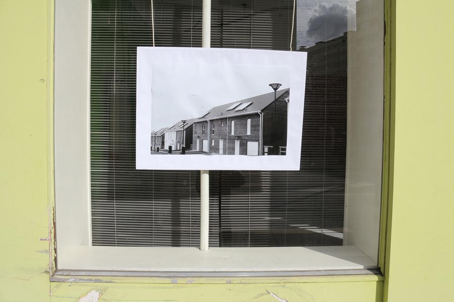 Using empty shop window to display art